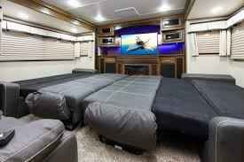 """2015 Used Grand Design Solitude 379FL Fifth Wheel in Texas TX.Recreational Vehicle, rv, 2015 Grand Design Solitude 379FL, 2015 Grand Design Solitude 379FL, For Sale BY OWNER, this luxurious living can be yours in this top of line, 2015 """"Grand Design Solitude 379 FL"""" ( front living room) 5th wheel. Perfect for living & entertaining with two 80"""" tri-fold sofas, a 58"""" theater sofa and a 50"""" LED HDTV with a fireplace below. The perfect setting for entertaining guests and enjoying a conversation…"""