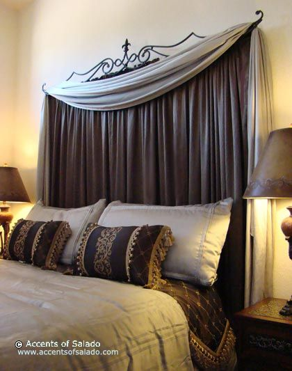 Instead of a headboard use a curtain rod to create draping behind your bed.