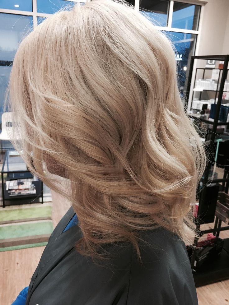 Beigey Blonde wand curl
