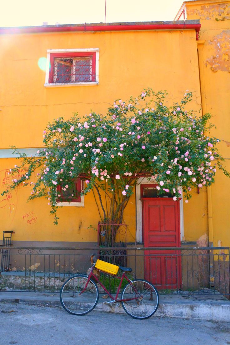A red and yellow house in Agiassos, a picturesque village to explore on Lesbos island, Greece.