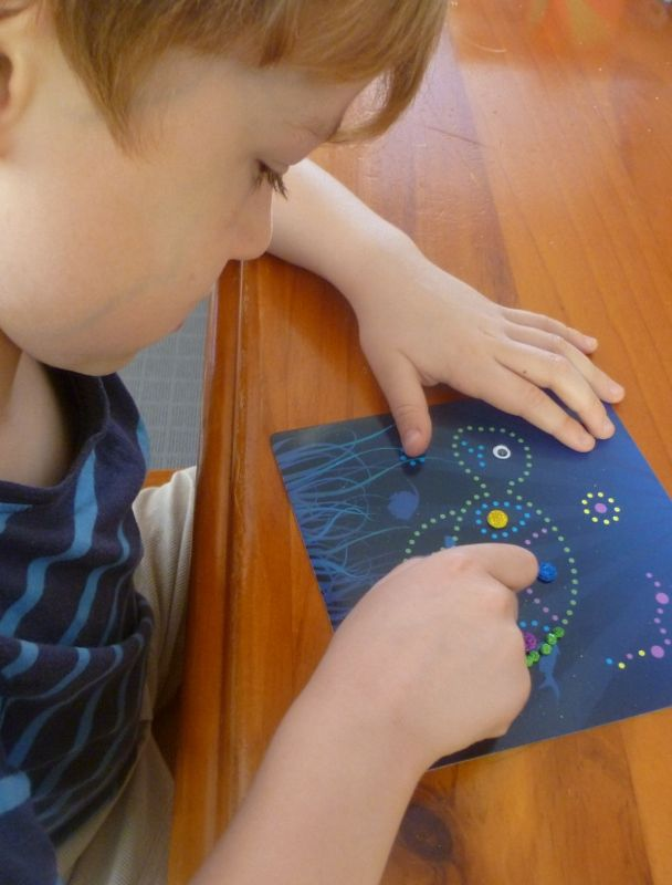 U is for underwater scenes - pincer grasp development using mosaic sticker art.