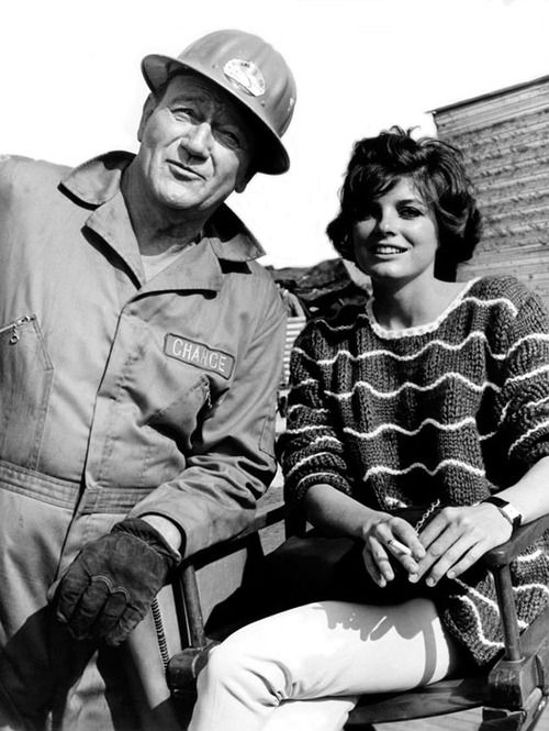 "Publicity photo of actors John Wayne and Katharine Ross from the set of the 1968 Andrew McLaglen film ""Hellfighters"". Click the pic to watch a scene from the movie."