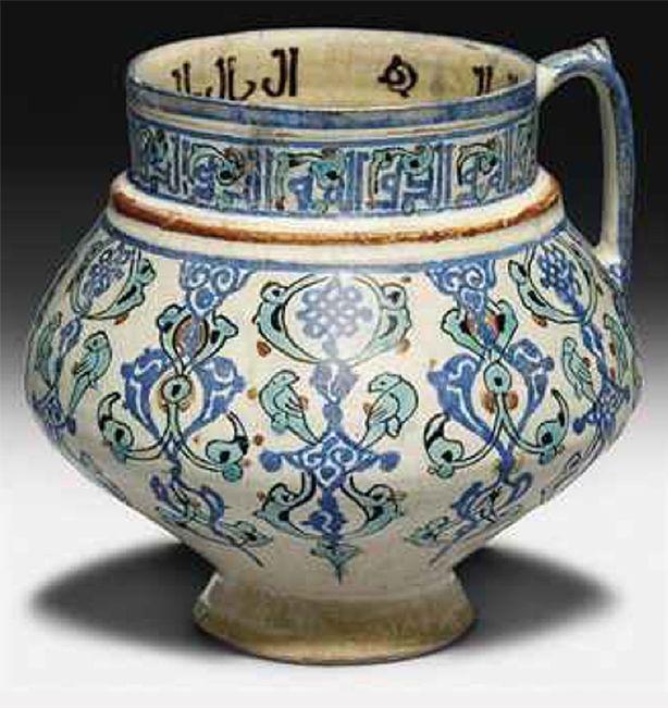 A MINA'I POTTERY JUG   IRAN, CIRCA 1200