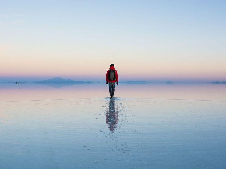 Picture of a traveler at sunrise on a tour of Salar de Uyuni, Bolivia