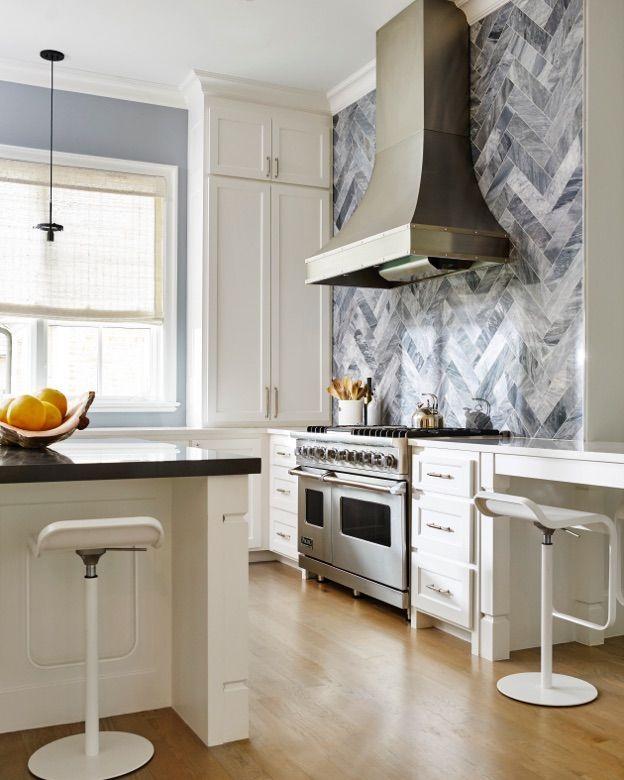 Marble Herringbone Backsplash Accent Wall In A White Kitchen