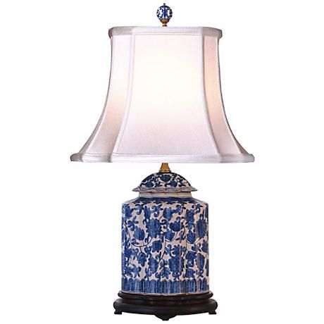 The scalloped, temple-ginger jar-shaped base of this porcelain lamp features a lively floral flower pattern in blue and white.