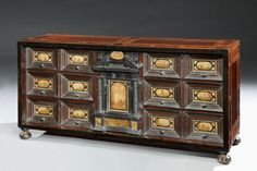 A 17th century, Italian, pietra paesina mounted, walnut, ebony and ebonised, table cabinet