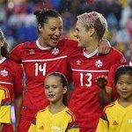 Melissa Tancredi #14 of Canada and Sophie Schmidt #13 laugh