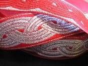 """CELTIC ROPE, (wide) SILVER ON RED  1 3/4"""" wide $3.45/yard"""