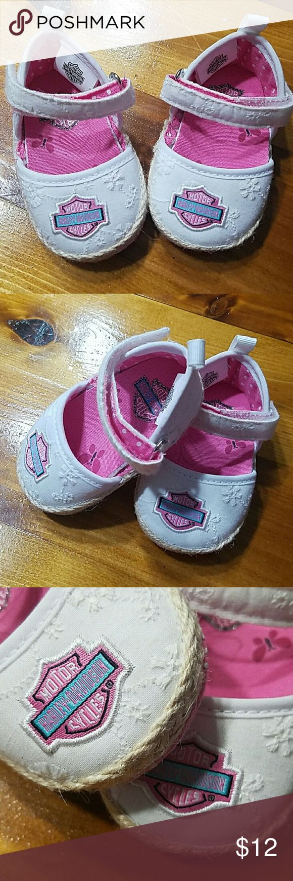 Baby girl harley Davidson shoes Harley Davidson shoes are white with a floral design stitched in also have the harley design in pink, velcro tie. Size 0/1 Shoes Slippers