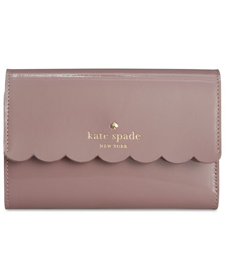 """Hold cards, cash and coins in kate spade new york's classic trifold wallet, a snap-open organizer styled in glossy patent leather with a sweet scalloped edge.   Patent leather   Imported   5-9/10""""W x"""