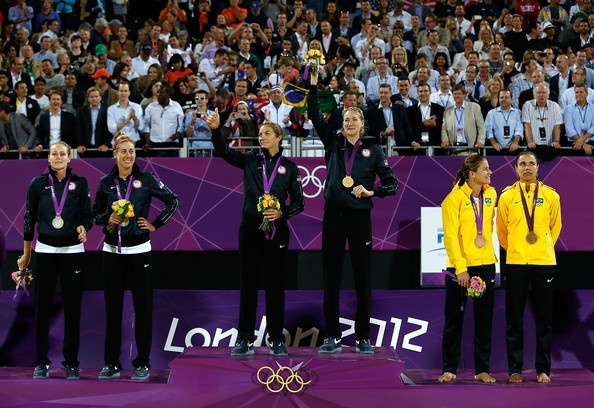 Silver medallists Jennifer Kessy and April Ross of the United States, Gold medallists Misty May-Treanor and Kerri Walsh Jennings, and Bronze medallists Larissa Franca and Juliana Silva of Brazil celebrate on the podium