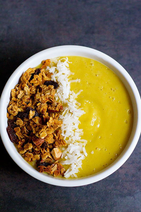 Start your morning with sunshine in a bowl! This tropical smoothie bowl has all the delicious flavors in one spoonful. Top it with some homemade granola and you've got yourself a delicious breakfast bowl!