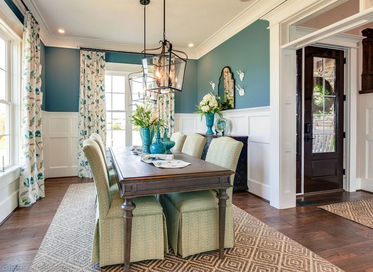 Teal walls are broken up and brightened with white for Dining room ideas teal