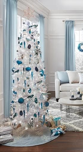 Go for something a little different and try a white Christmas tree this season. Adorned in blue ornaments, this Christmas tree has a cool, fresh look leading into winter. Experience that winter wonderland feeling in your home with a tall white Christmas tree.