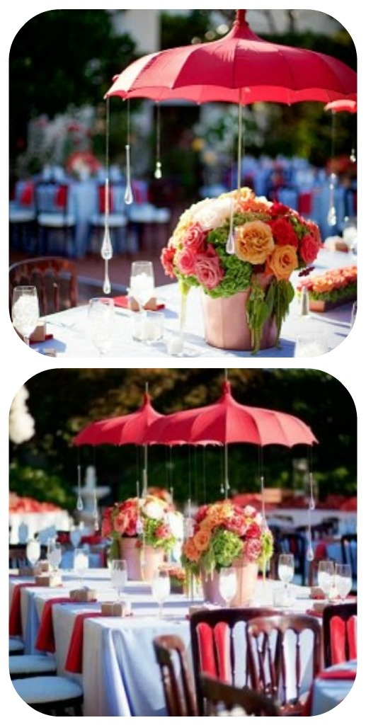 Love this- the old fashioned red umbrellas, and the pretty flowers underneath. I think my favorite part though is the glass raindrops hanging down.