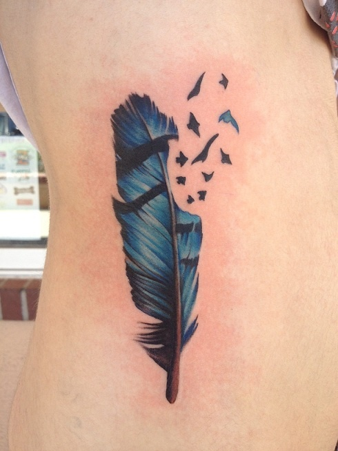 """I've always had a strong connection with blue jay birds, and have recently gotten over my fear of birds. The birds breaking off of the side represent breaking away from the bigger part of life and starting your own path, away from the past."""