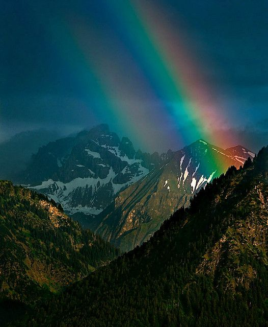 Mountain rainbow . Bavaria , DE. Beautiful pic: God's promise never to destroy all of mankind by water again. He has made many promises. He keeps them all.