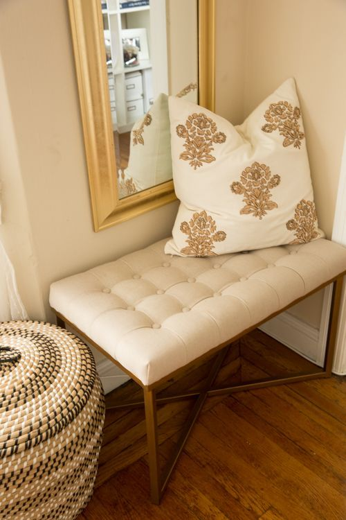Target Tufted Bench Embellished Pillow And A Gold Framed Long Mirror In Living Room Nook