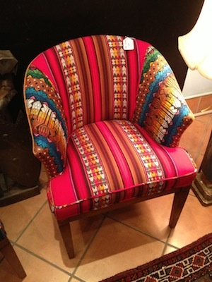 Love this chair reupholstered with a bright southwestern inspired fabric.