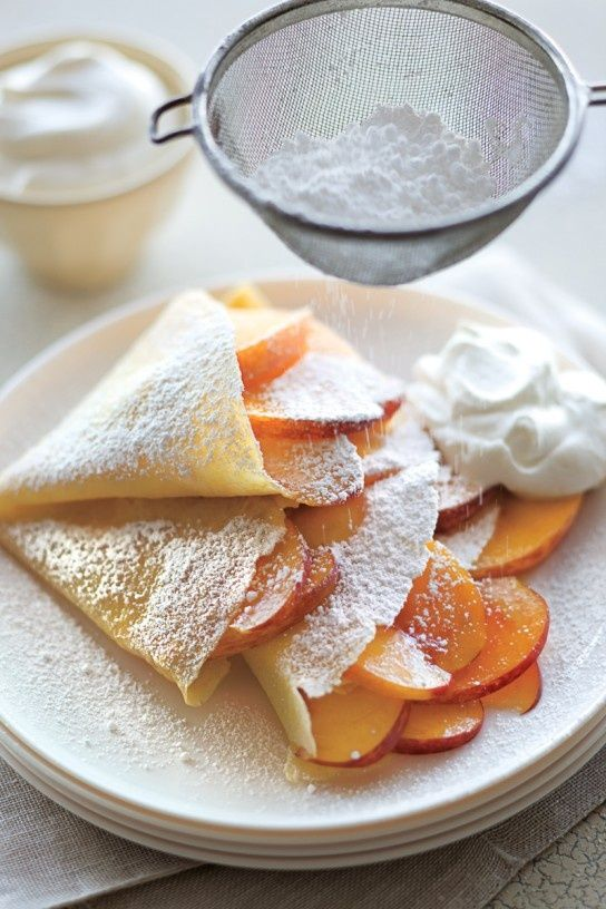peaches & cream crepes       1 cup whole milk  1/2 cup all-purpose flour  1/2 cup yellow cornmeal, preferably stone-ground  2 large eggs  5 Tbs. unsalted butter, melted  1 tsp. granulated sugar, plus more to taste  1/4 tsp. fine sea salt  4 peaches, halved, pitted and thinly sliced  1 Tbs. fresh lemon juice  Canola oil for cooking  1/2 cup masc
