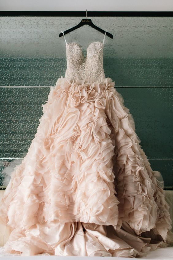 This beautiful dresses looks like a bunch of clouds. Every girl has a pink dress dream, it is so fantastic if you realize your dream in your big day! Wish you have a happy pink bubble wedding ceremony and get inspired from the following gallery.