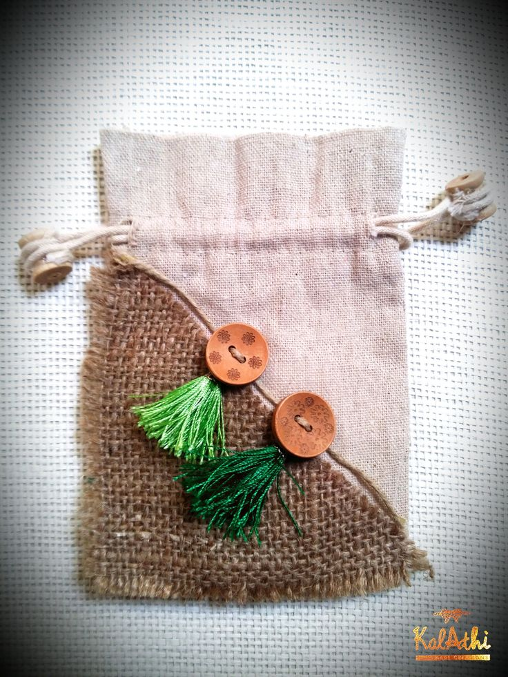Linen pouch with wooden buttons & little tassels by KalAthi photo © KalAthi