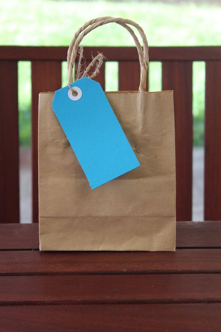 Add bright Blue Tags to a kraft bag