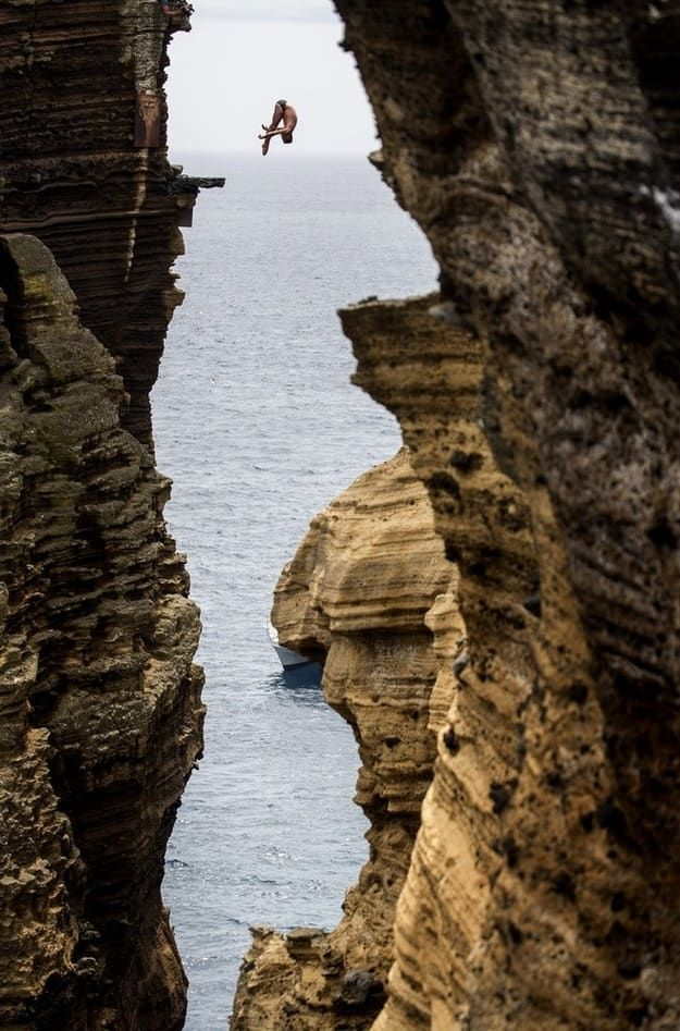 Blake Aldridge dives 29 meters from the rock monolith during the Red Bull Cliff Diving World Series in Portugal.