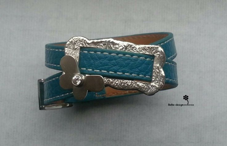 Blue leather bracelet with a silver butterfly