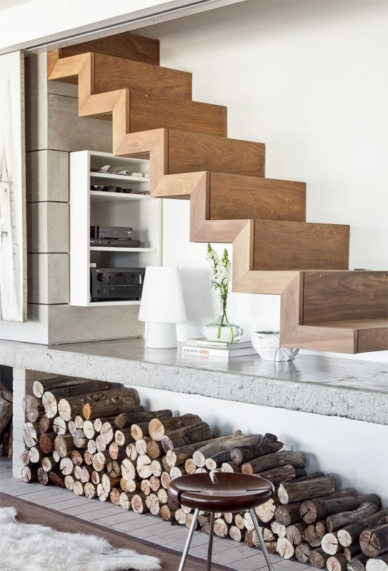 concrete, firewood and statement stairs