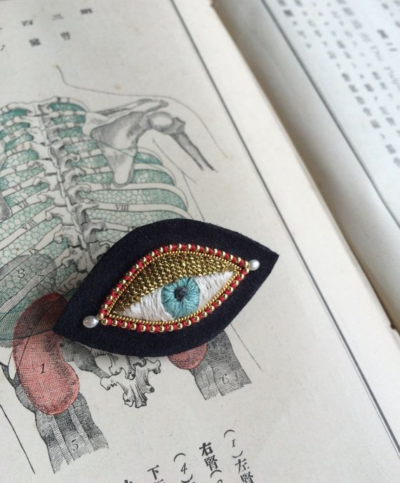 Gorgeous handmade black eye brooch with pearls by zoomy on Etsy