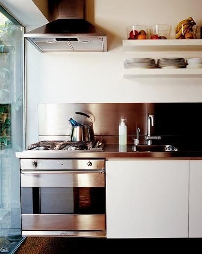 Move Over, Tile: 5 Backsplashes Made of Sheet Materials Here: stainless steel sheet backsplash (maybe not all the way up to the cabinets?)