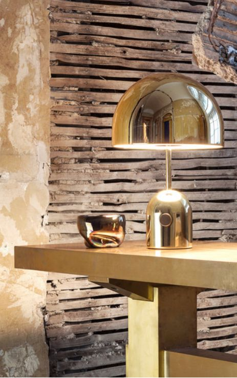 The Tom Dixon Bell Light is an exercise in reductionism with its dome suspended over a dome formed of brass plated pressed steel.