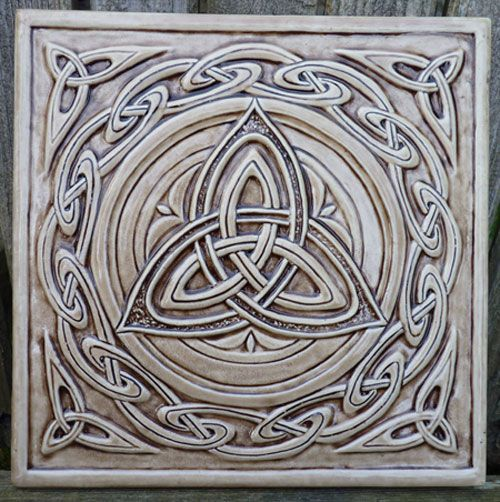 """Central triskelion surrounded by a """"Celtic wave"""" border.  OK. Not zelij, but it's always nice to contrast and compare (and ask, how would a zelij artist render a triskelion?)   Celtic ceramic tile"""