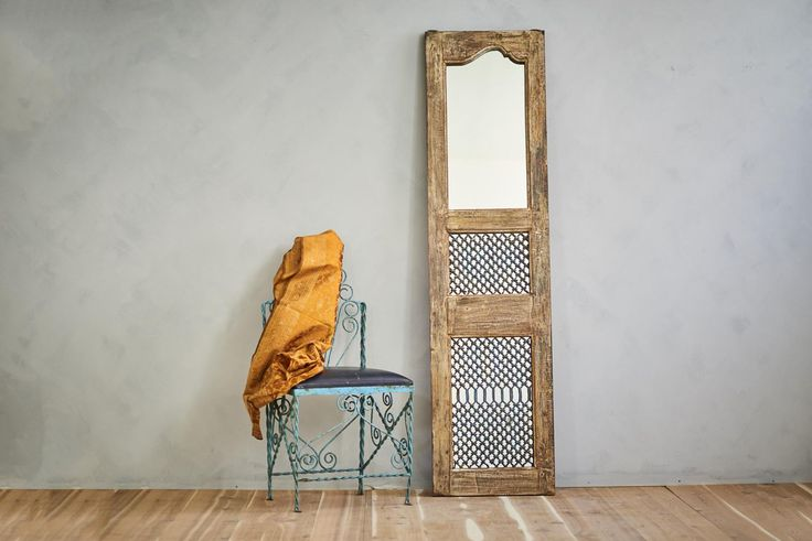 This floor mirror or wall mirror with a frame made from a reclaimed door  panel, will be the perfect anchor to your Moroccan decor or Mediterranean  space. As an accent for a stairway landing, a grand bathroom piece, a salon  station mirror or used in a retail setting, the hand made iron work of