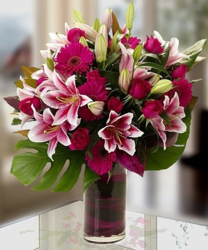 Ce La Vie! Hot Pink Fiery Roses, Fiery Stargazer Lilies and Gerbera Pastel Daisies! Carithers offers same day delivery anywhere in the USA. http://www.carithers.com/flowers/Luxury-Flower-Arrangements-Ce-La-Vie-Atlanta-Delivery/