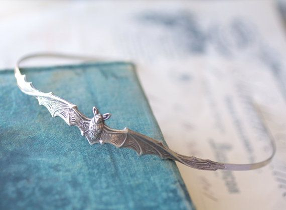 Antique Victorian style silver finish vampire bat headband.  The bat is centered on the top of the band and measures 4 3/4 (120mm) long by 5/8 (16mm)