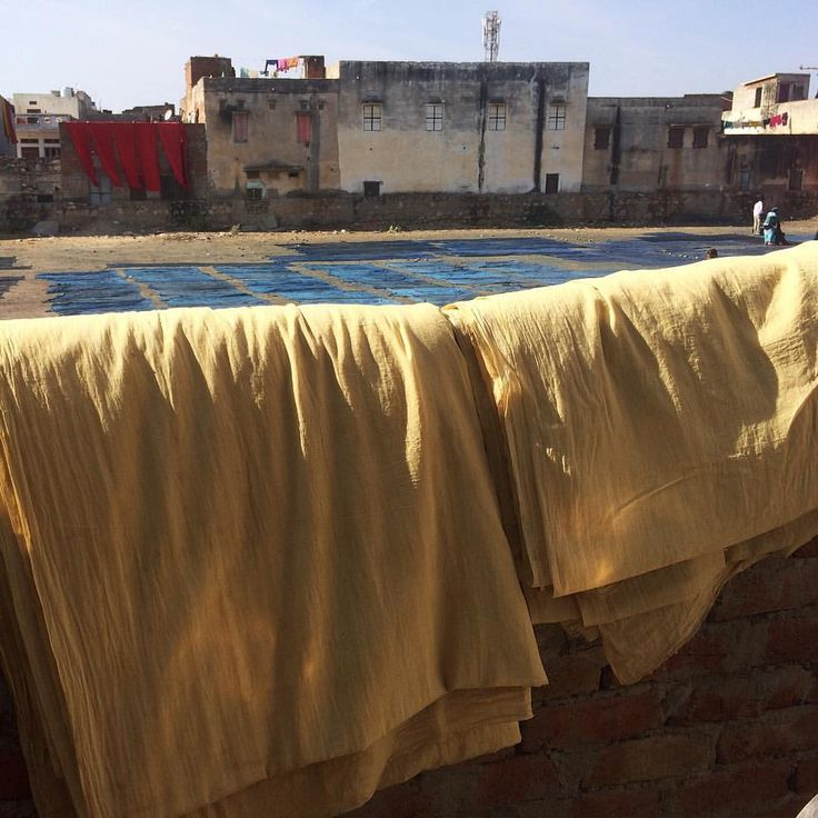 """Our cotton fabric prepared and ready for the block printing process ... Indigo drying in the…"""""""