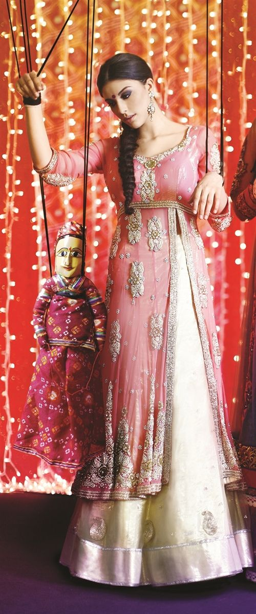 Light salmon and cream colored outfit perfect for a south Asian bride, engagement outfit