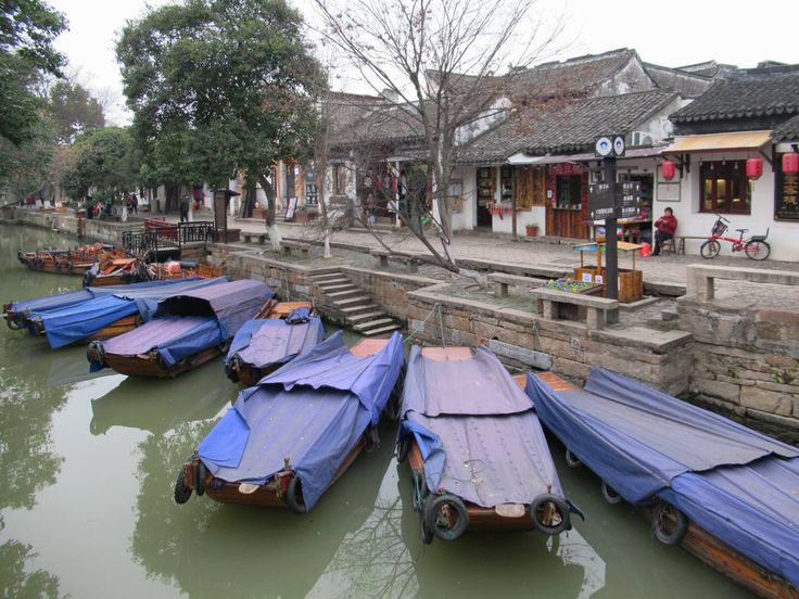 Wooden boats are used to navigate the canals of the old town of Tongli, 24 kilometers southeast of Suzhou, China.