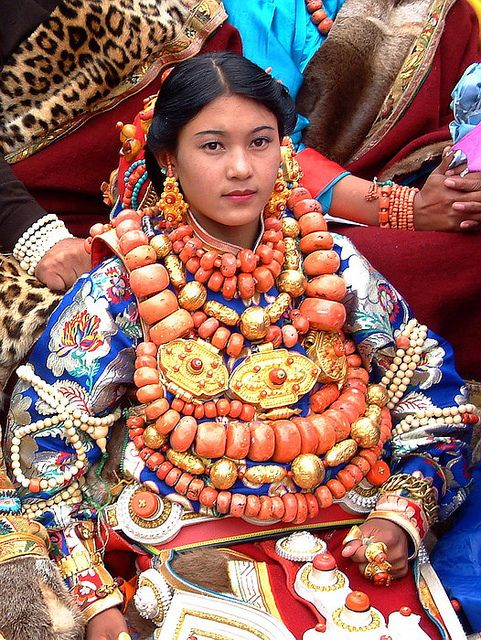Young Khampa Tibetan Lady wears incredible, beautiful, very heavy and extremely valuable traditional Tibetan jewelry at the 4th Khampa Arts Festival in Kangding 2004.