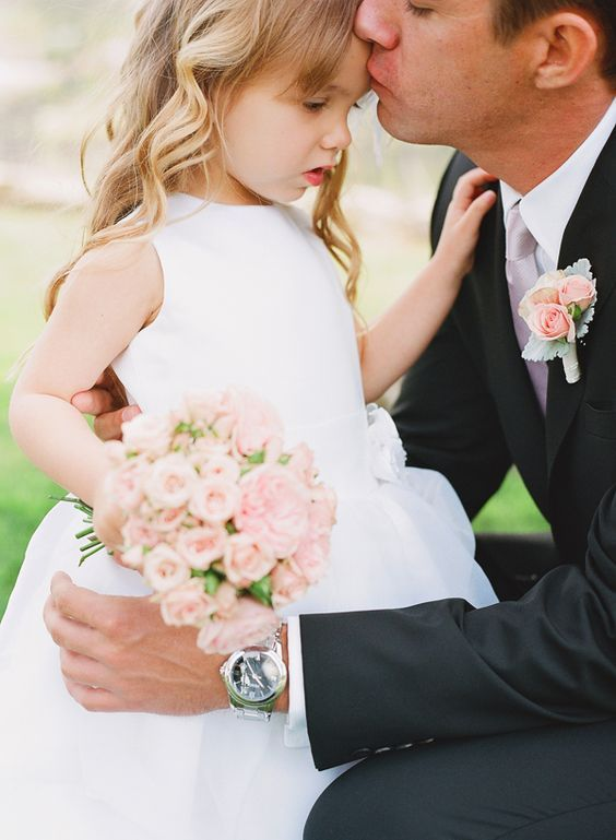 groom with flower girl