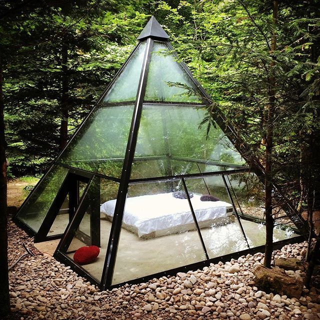 in la chapelle-aux-bois, a commune in the vosges mountains in eastern france, 'la ferme aventure' is a theme park that offers accommodation within this transparent glass pyramid which allows visitors to experience nature in a new way. photo by alsace