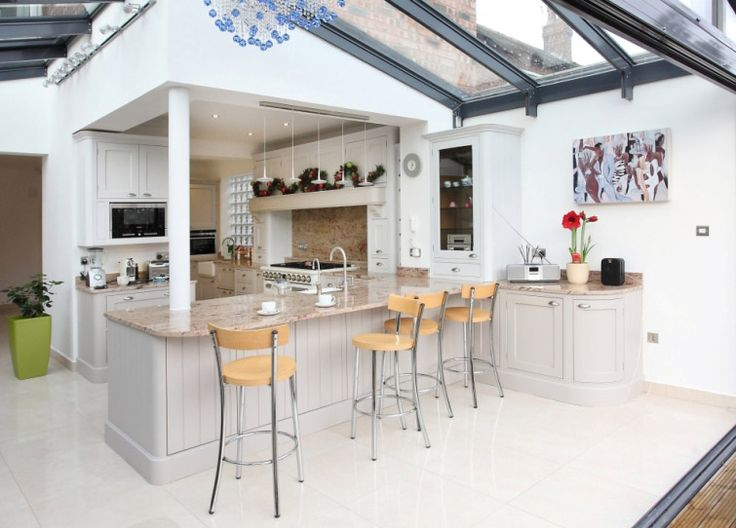 Open and bright contemporary kitchen extension with bar and stools