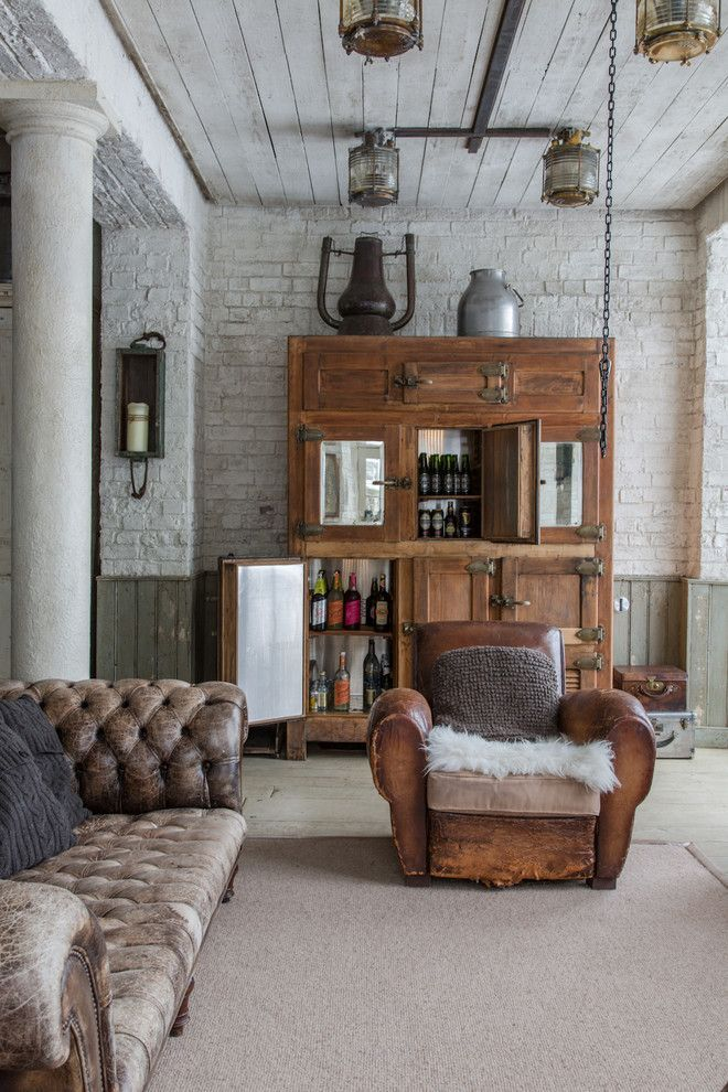 Brick walls, old wood cabinet, worn leather seating, lighting