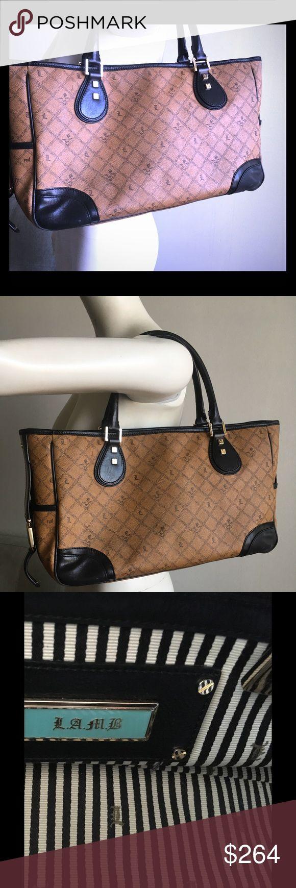 Lamb Handbag Beautiful handbag in mint condition  inside clean  100%authentic  lamb bag. Colors brown black and white  outside has signature stamp  L lamb Bags Satchels