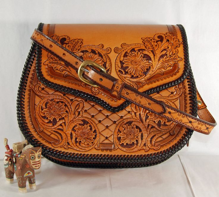 Hand Tooled Leather Laced Purse. $300.00, via Etsy.