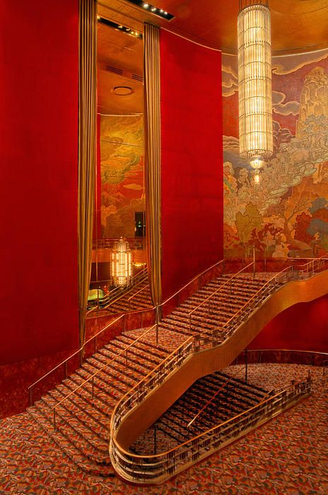 Lobby Stairs at Radio City ~Dave Mills ~   Radio City Music Hall is a New York City landmark. It's Art Deco Design along with the bold red colors are captivating to the eye.