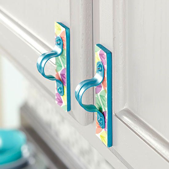 Created from wood shims, graphic paper, and pipe straps, these cabinetry pulls go easy on the pocketbook. Spray-paint shims (cut to 4 inches long) and pipe straps. Use decoupage medium to adhere the paper of your choice to the wood. After it dries, attach the pipe straps with an industrial-strength glue, such as E6000. Screw the pull directly into the cabinet door
